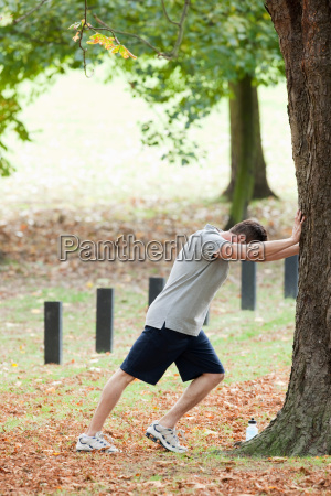 man stretching for a workout in