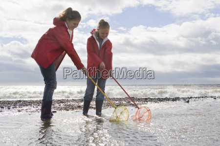 mother and daughter fishing with fishnet