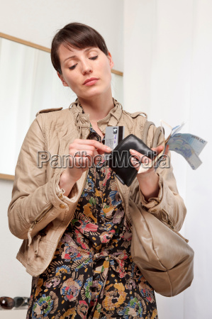 woman putting card in wallet