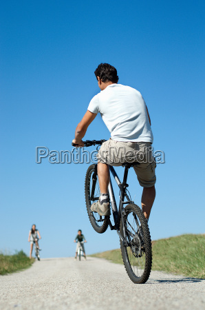 father with family doing a wheelie