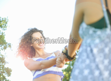young woman being swung by her