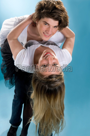 happy young couple bend together embrace
