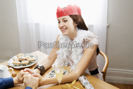 woman smiling holding mans hands