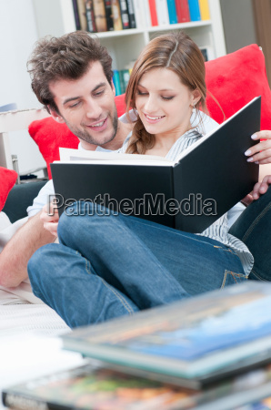 couple reading together a book on