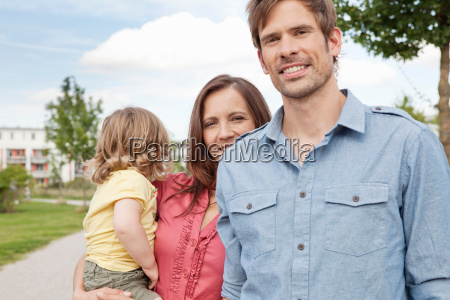 family standing together outdoors