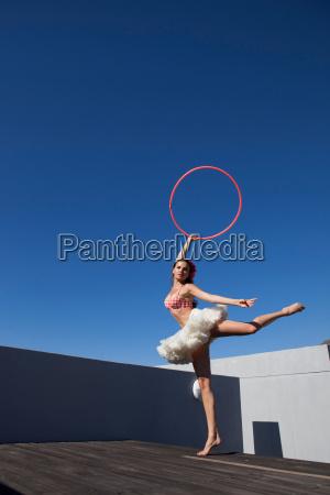 woman in tutu dancing with hula