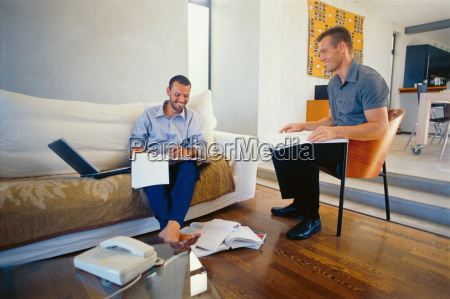businessmen working in living room