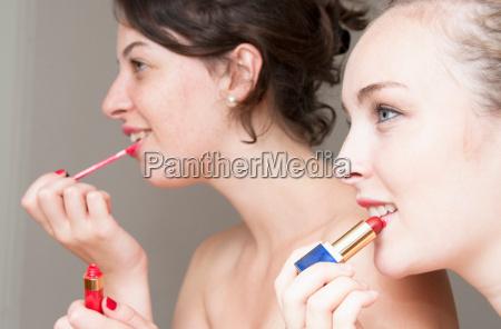 teenage, girls, applying, makeup - 18285212