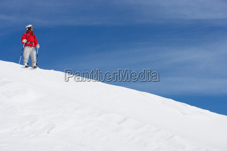 male skier standing on snowy slope
