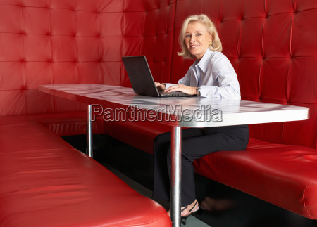 businesswoman working at a table