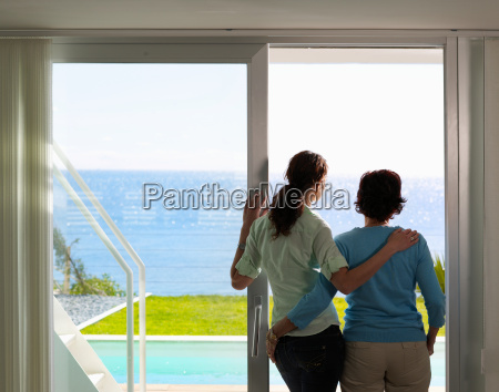 mother and daughter looking out to