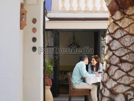 couple sitting on garden terrace
