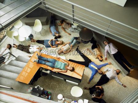 businesspeople lying on the floor