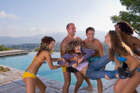 men and women throw a friend