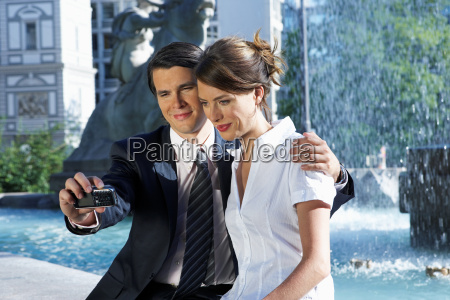 young couple taking picture together