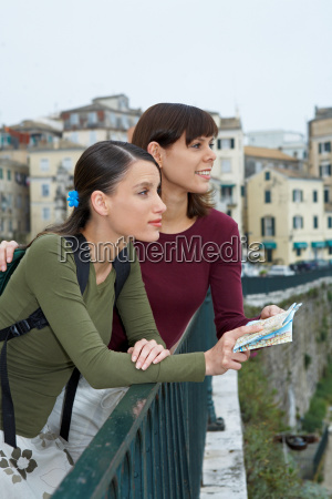 two young women with map