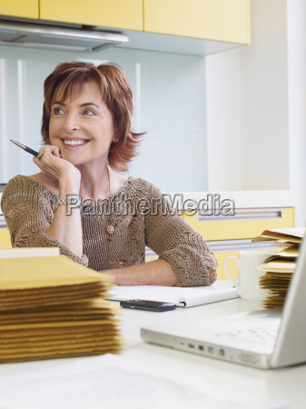 senior woman running business from home