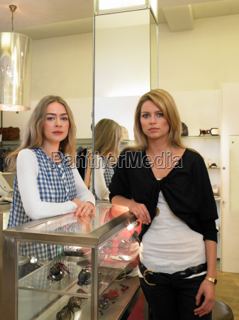 two women leaning on counter