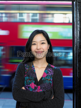 young woman in street smiling portrait