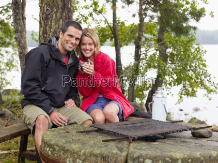 couple sitting in a park by