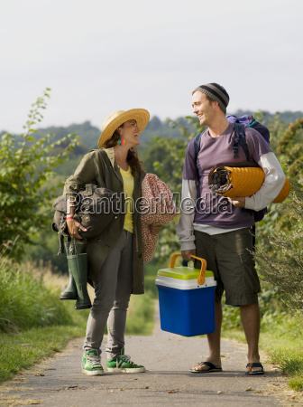 woman and man standing on path