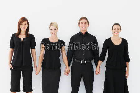 four business people holding hands