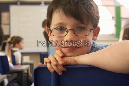 boy looking at camera in classroom