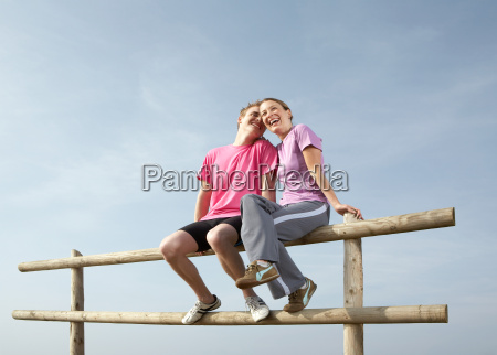 a young couple sit on a