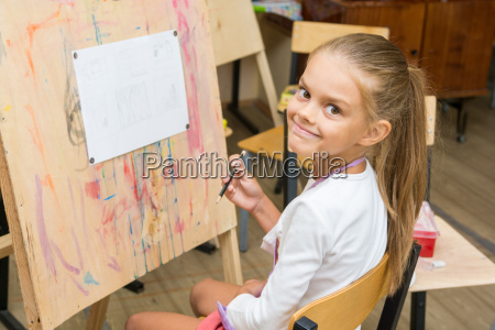 girl happily looks into the frame