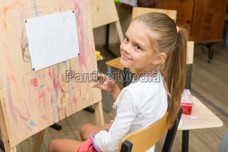 girl happily looks at the teacher