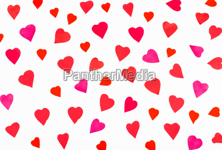 many pink and red hearts carved