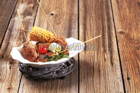minced meat kebabs and roasted sweetcorn