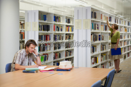young man working in library