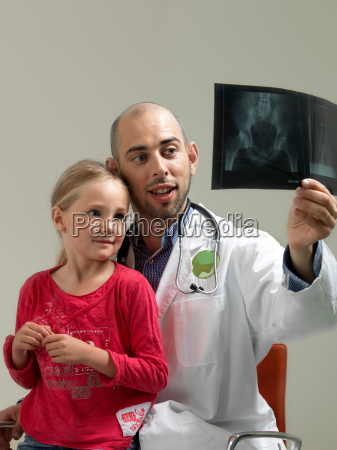 doctor and girl with x ray