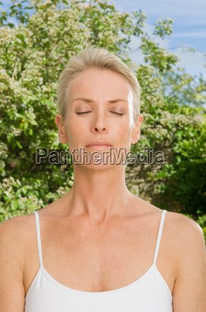 portrait, of, woman, with, eyes, closed - 18303922