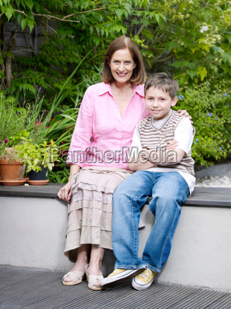mum and son sitting on patio