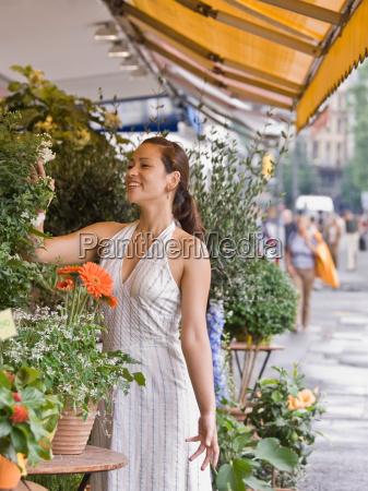 woman shopping in a flower shop