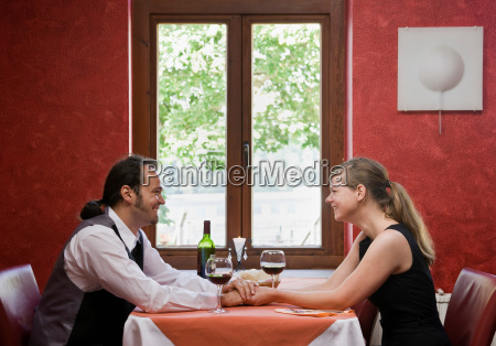 man and woman having dinner together
