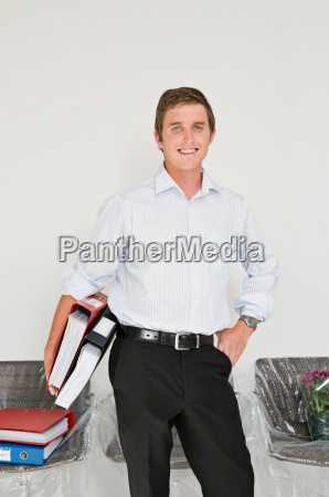 a business man with files under
