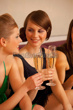 young women chatting drinking champagne