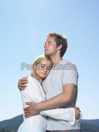 couple embracing in sun