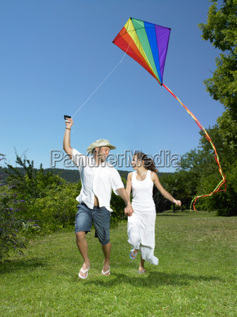 man and woman flying kite
