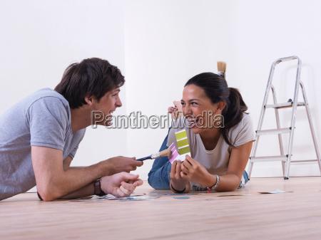 couple choosing paint colours