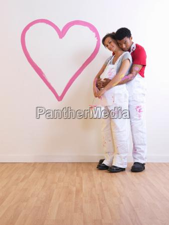 man holds pregnant girl