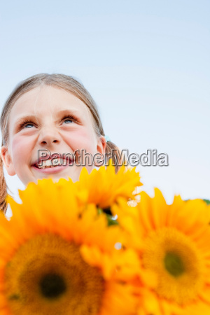 young girl with sunflowers