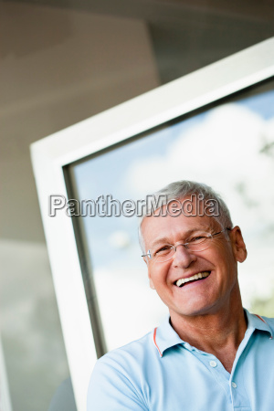 senior man smiling to camera