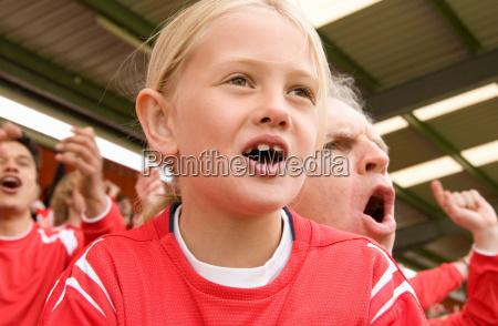 fans singing at football match