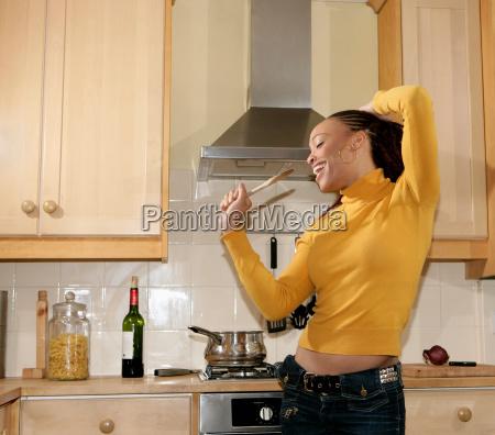 girl singing in kitchen