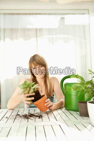 young woman and plants on patio