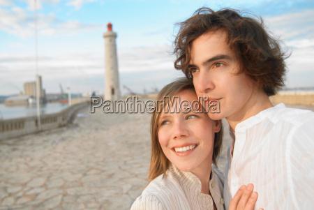 couple admiring sunset on pier